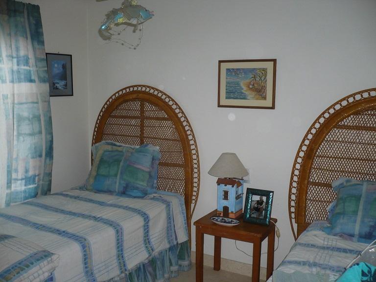gurest bedroom has comfortable twin beds,closet and garden view