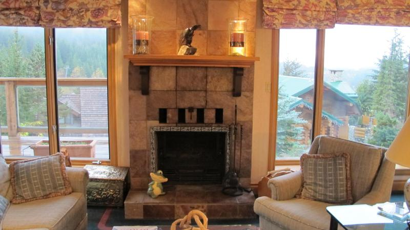 Main living room fireplace and the gondola tower in view outside the left window