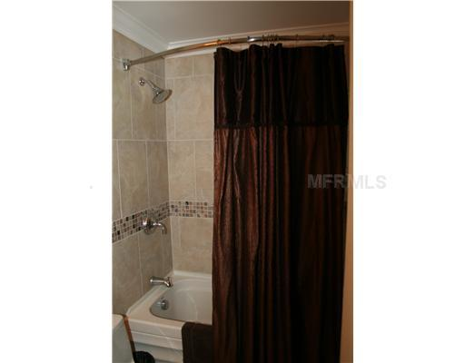 Shower/ Tub combo with grab bars