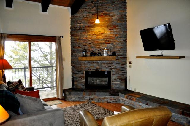 New stone fireplace, furniture and TV