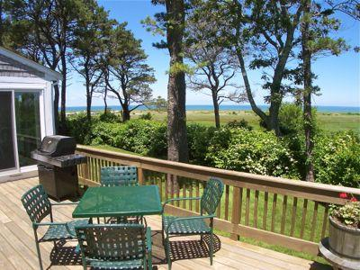 Chill, grill and enjoy the 180-degree vista of the East Brewster marshes, Crosby Landing Beach and sunsets over Cape Cod Bay.