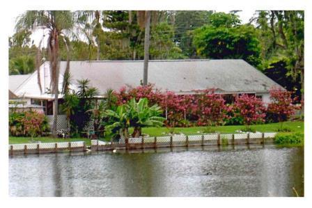 The Main House and Pool Gazebo From Across Flamingo Lake
