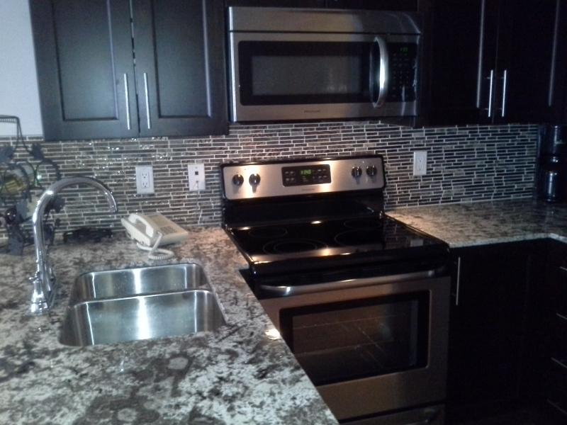 Kitchen with granite counters and upgraded cabinets