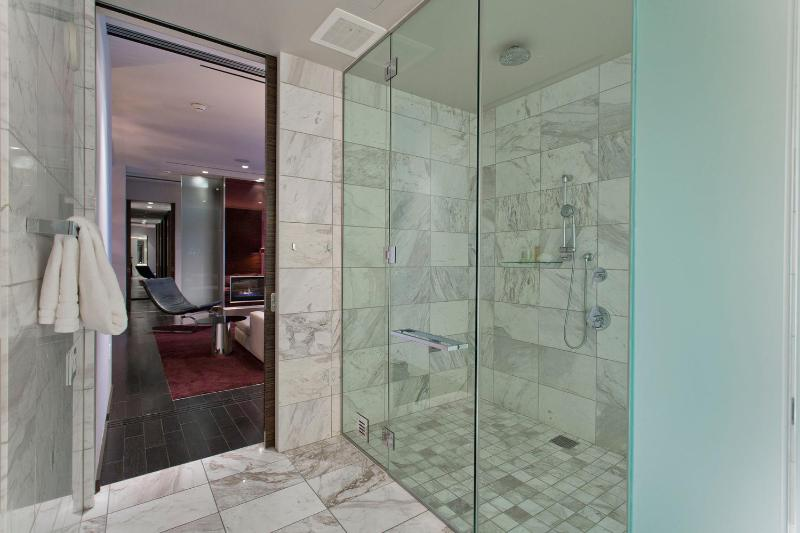 second bathroom from the inside, shower on the right
