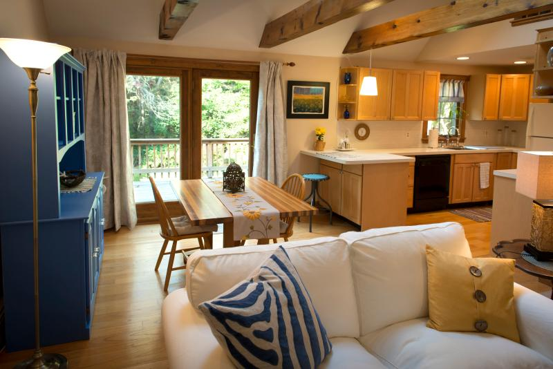 Welcome to Settling Inn. Open living room with exposed wooden beams