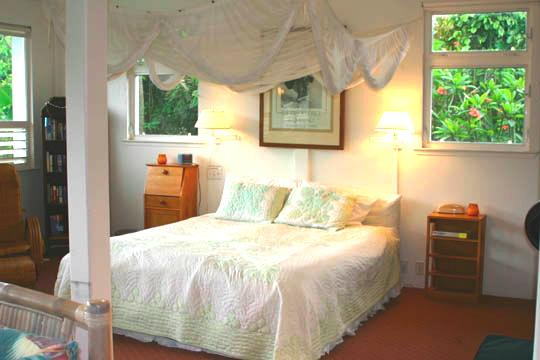 Romantic Honeymoon Bed with Fragrant Plumeria Flower Trees outside both bedside windows