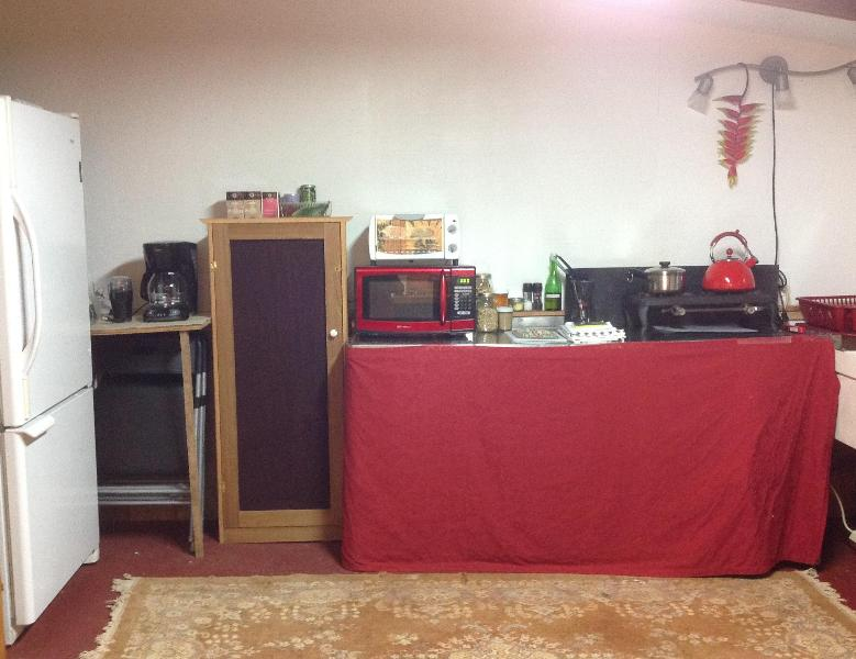 Country style kitchen fully equipped with fridge, stove top, microwave, toaster oven, coffee maker & grinder