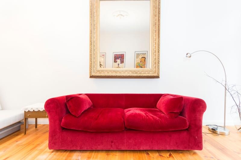Old Vintage mirow from a Berlin restaurant paired with a modern couch