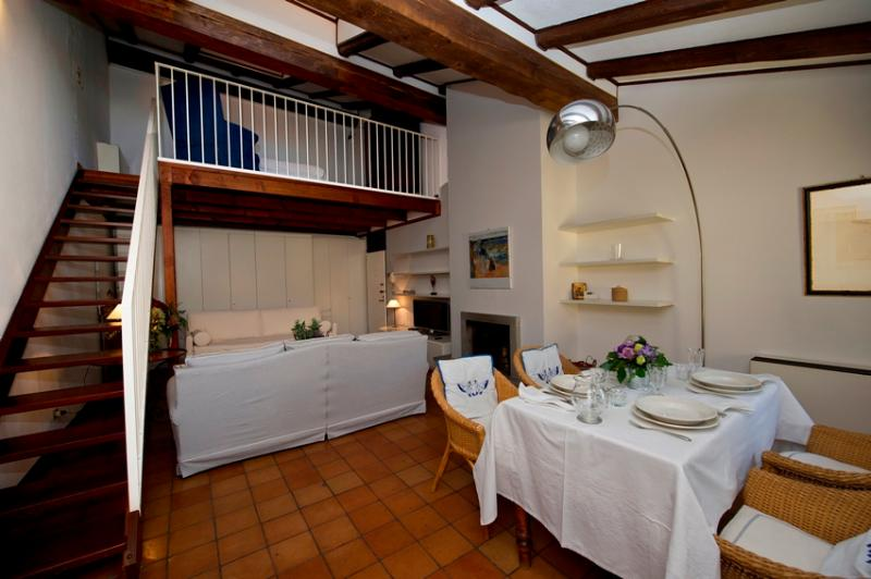 The main room with the loft. Timber ceilings, wooden and tile floors - Bolognese tradition.