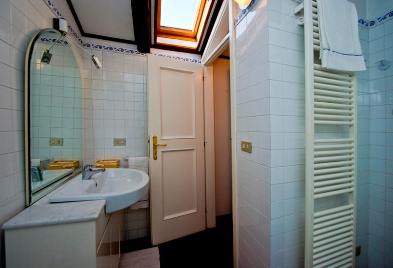 The en-suite bathroom features a tub and a shower. Both bathrooms are being kept immaculate clean.