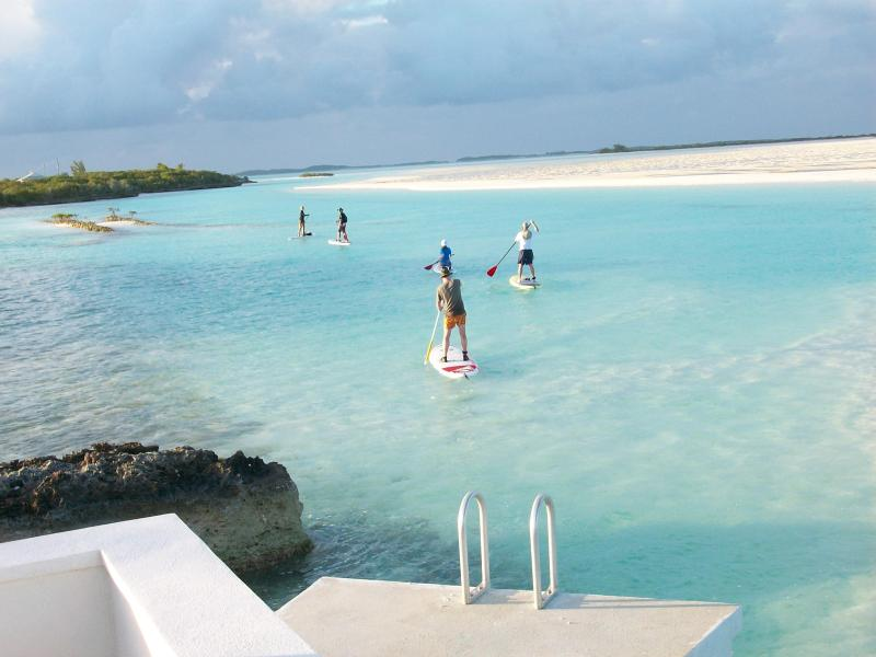 Guest paddle-boarding in front of our gazebo.