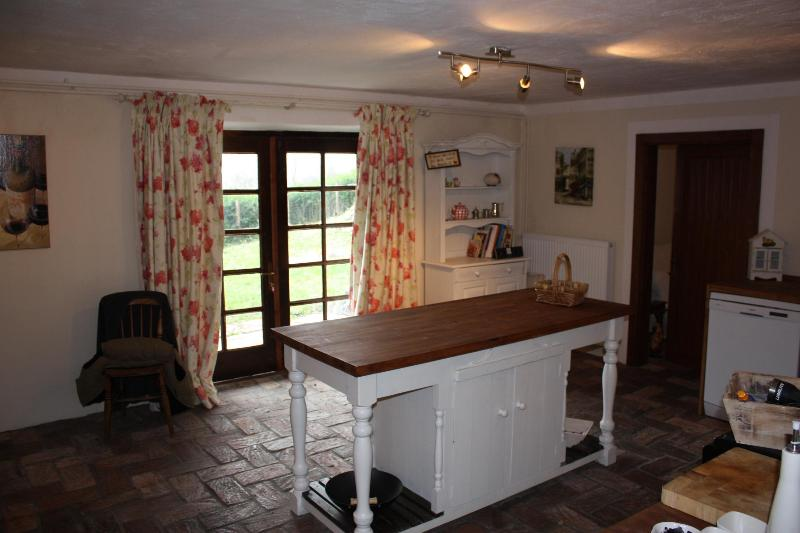 Fully equipped rustic kitchen looking out to garden
