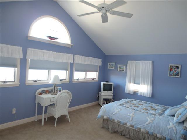 2nd floor master bedroom with views of pond and queen bed