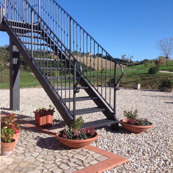 Wrought iron staircase leading to Rondine apartment