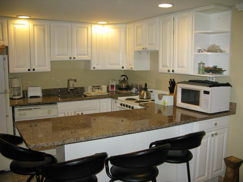 eat in kitchen, with granite counters, marble floors