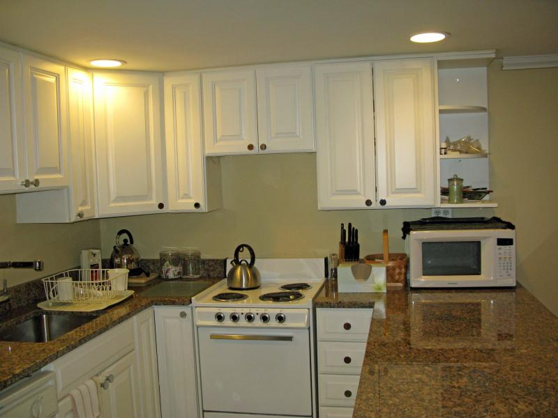 different angles of fully equipped kitchen