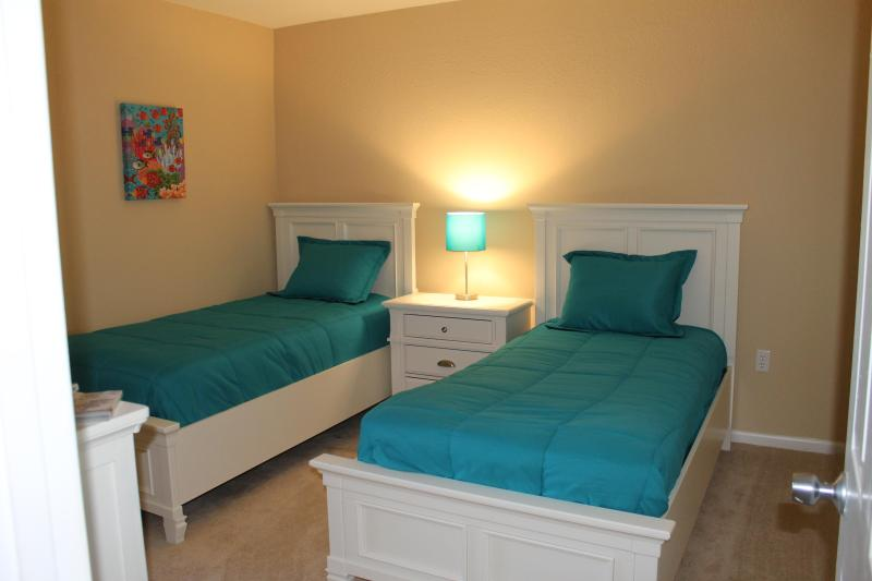 2nd beroom, 2 twins, with pull out extra mattress under the bed on the right.