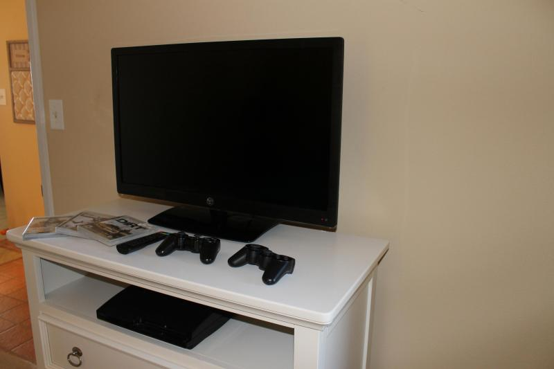 2nd bedroom TV with PS3 game console and 6 games.
