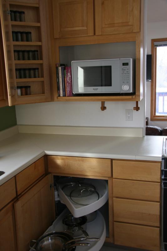 kitchen with spice rack hidden in door