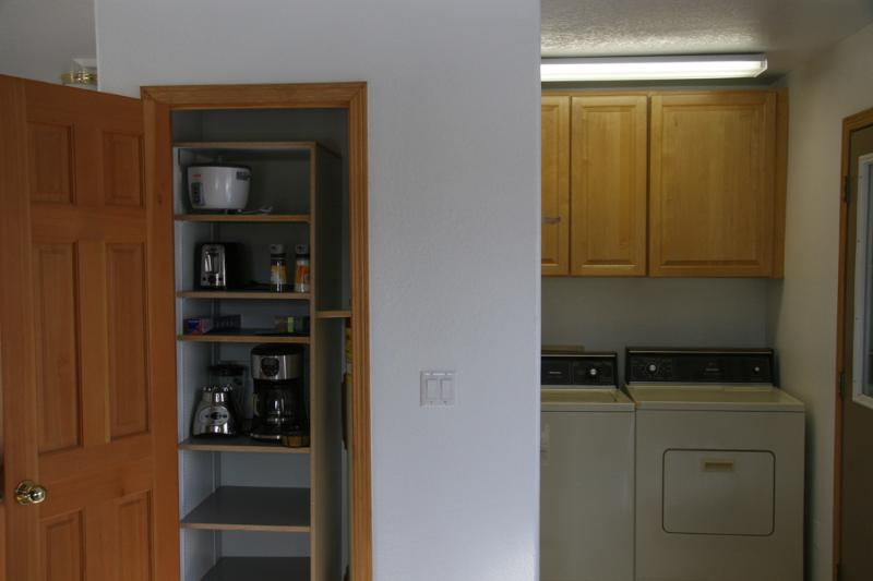 laundry room with full size washer dryer and pantry: coffee maker,blender; toaster,rice cooker