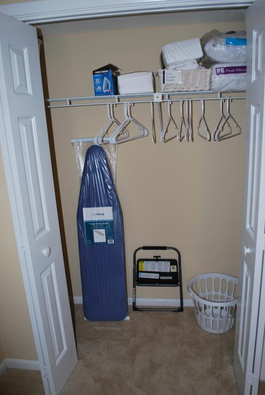 Masterbed room closet, iron w/ironing board.
