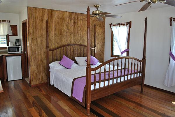 Bed in Purple Crowned Fairy Cabana at Latitude Adjustment in Hopkins Belize