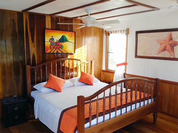 Bed in Orange Starfish Cabana at Latitude Adjustment in Hopkins Belize