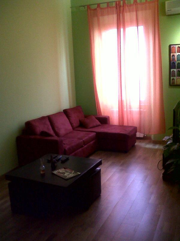 Habitación doble salón sofá