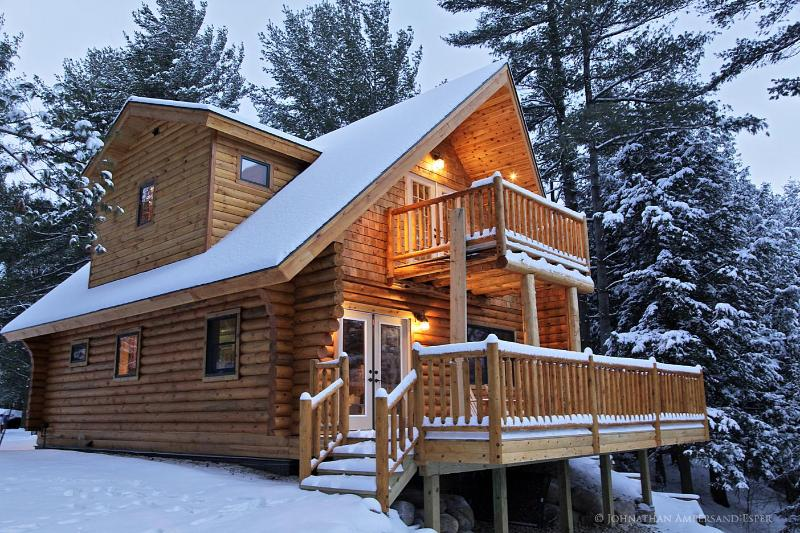 a cozy Adirondack Log Home in winter