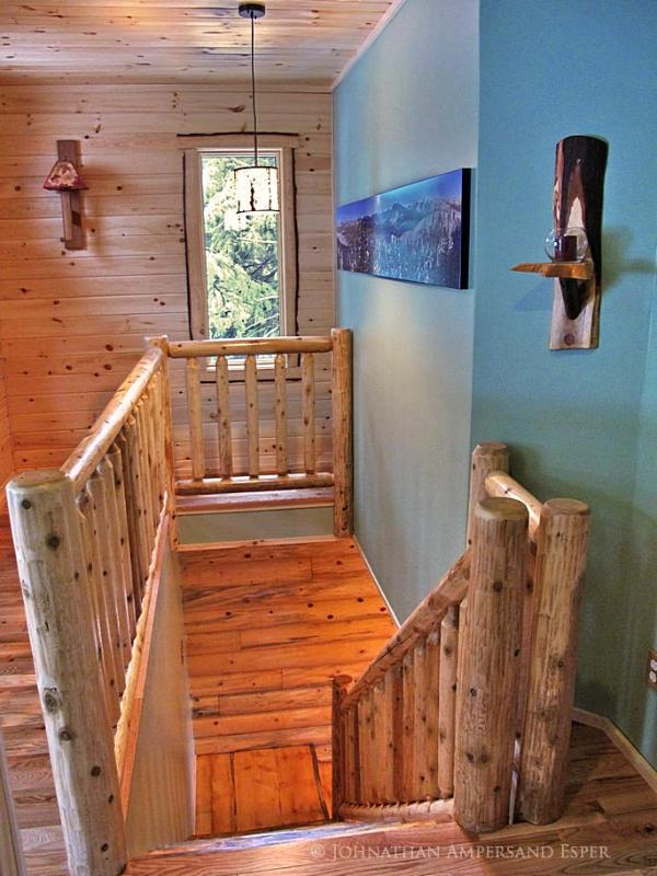 stairs including rustic fixtures and cedar railings