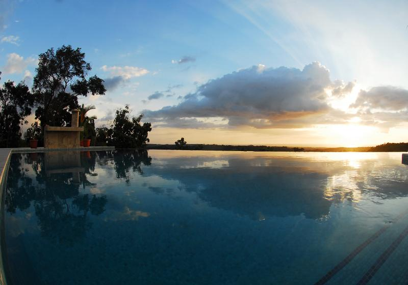 One of many consistent & different sunsets you will see while lounging around the pool terrace