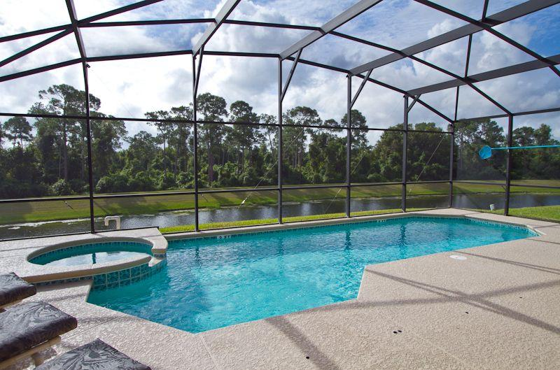 Large pool deck with lake and woodland conservation area views