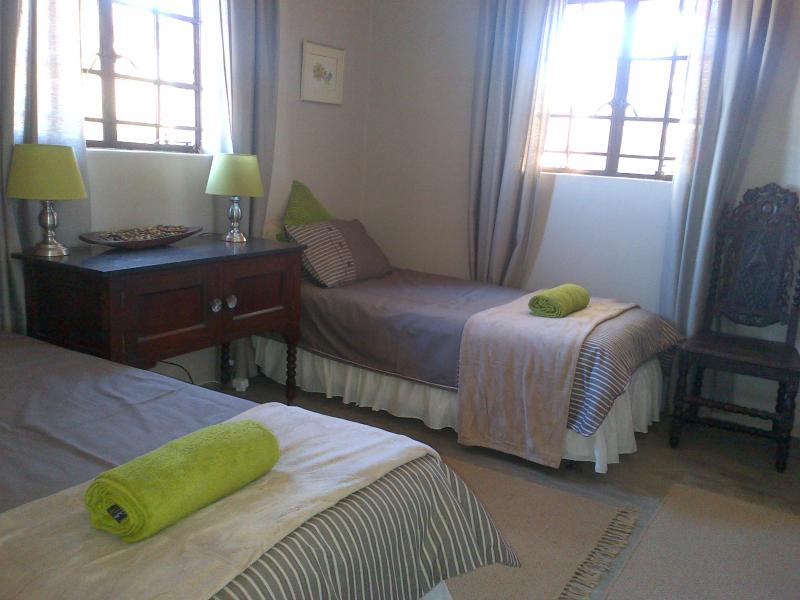 Karee Cottage third bedroom with twin single beds, with all linen supplied