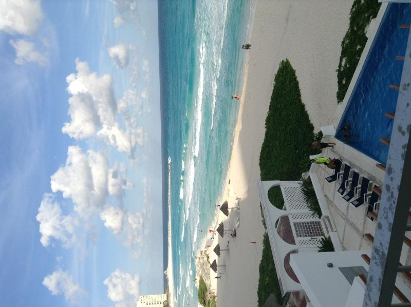 View from the balcony, stunning beach and blue Caribbean