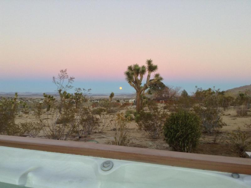 Full moon rising at sunset as viewed from hot tub
