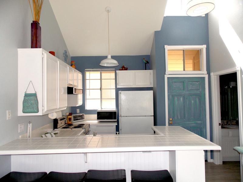 Full kitchen with stove & oven, dishwasher, refrigerator, microwave and toaster