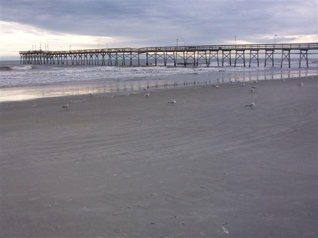 Sunset Beach and pier at low tide