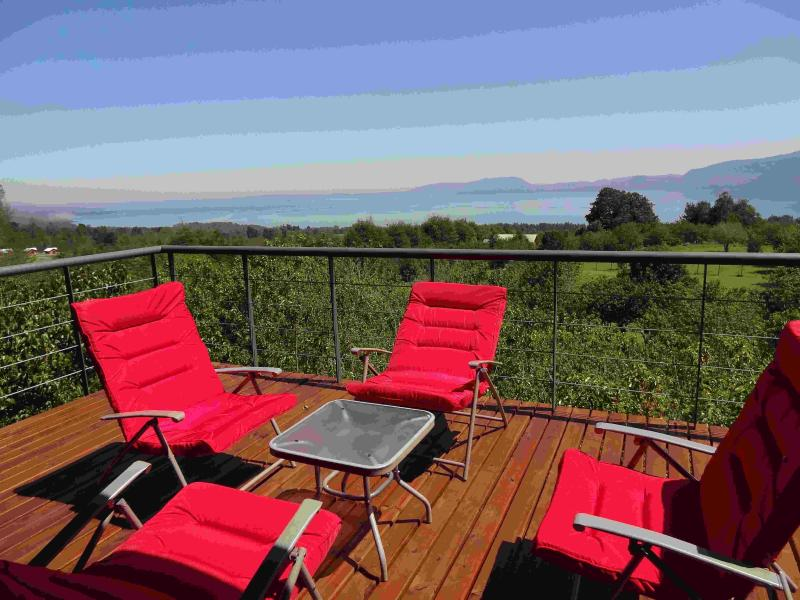 Red Chairs on the Deck with View of Lago Villarrica