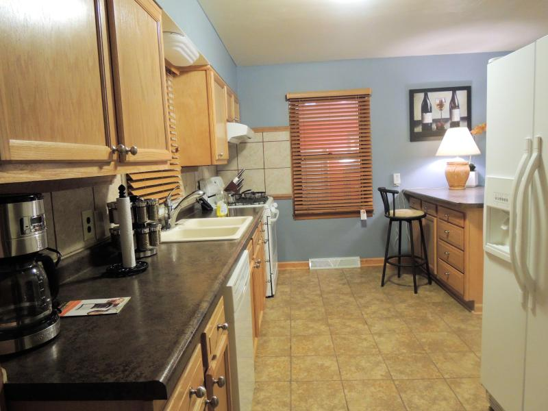 into kitchen from deck and coffee maker and waffle maker