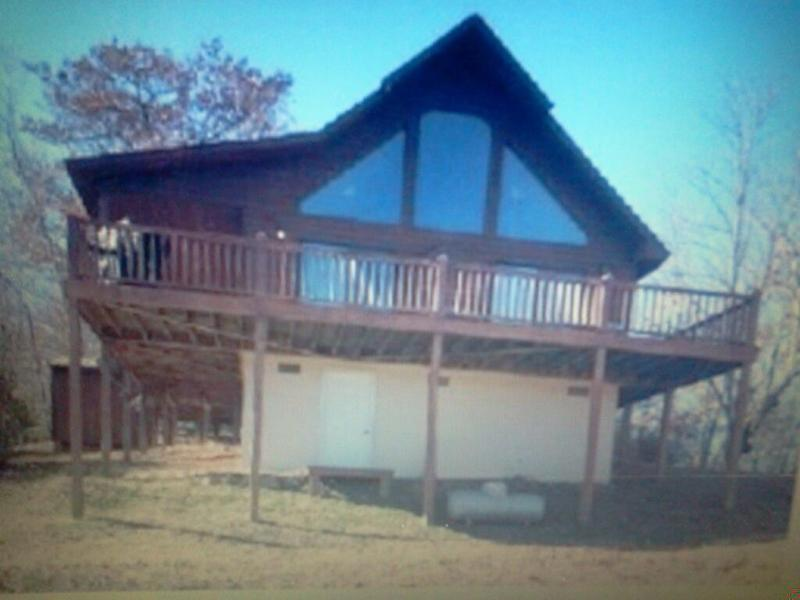 Our 2 story, cedar siding chalet with wrap around deck