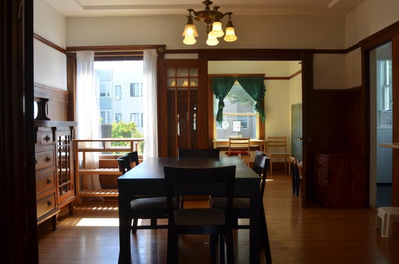 Formal dinning room and adjacent sunroom.