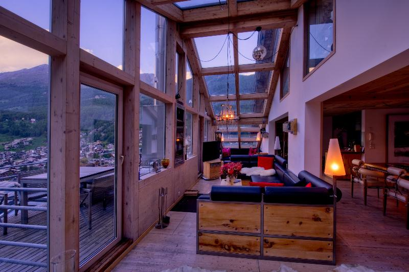 Due to the extensive use of glass roofs, the chalet has great views to the village and mountains.
