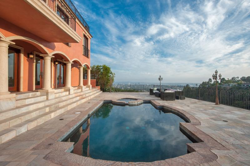 HUGE 3,000 SQ. FT DECK WITH A VIEW.  HEATED POOL AND SPA.