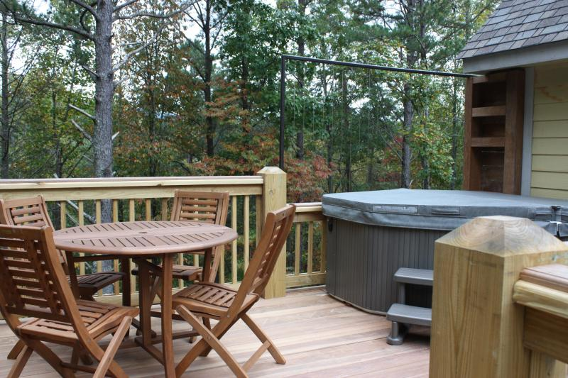 Deck outside apartment with hot tub