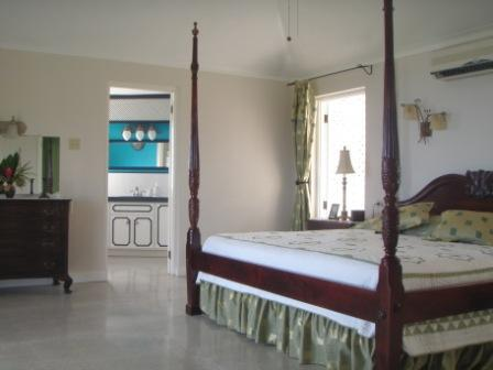 Master Bedroom and bath - with a Balcony overlooking Ocho Rios and the Caribbean below!