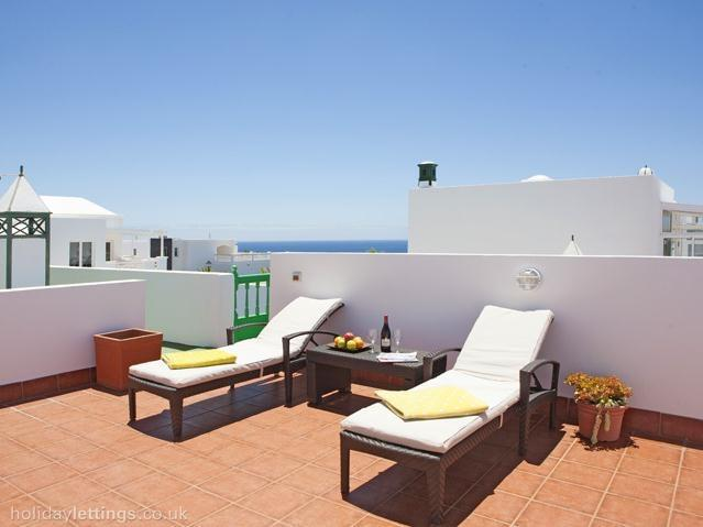 Sun loungers on roof terrace