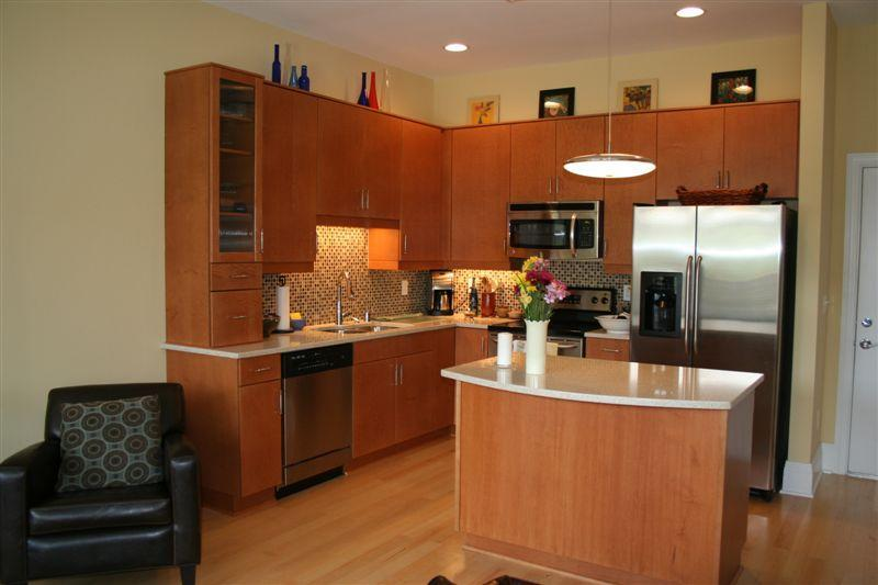 Well stocked, fully equipped kitchen includes stone countertops and stainless steel appliances.