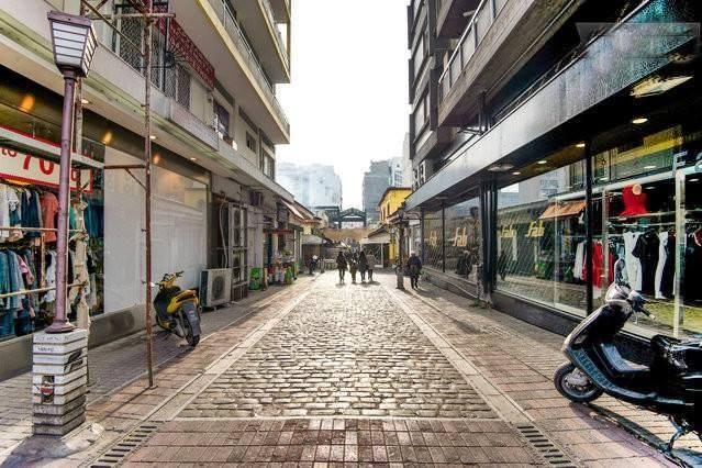 Traditional paved street under apt with tavernas and live music