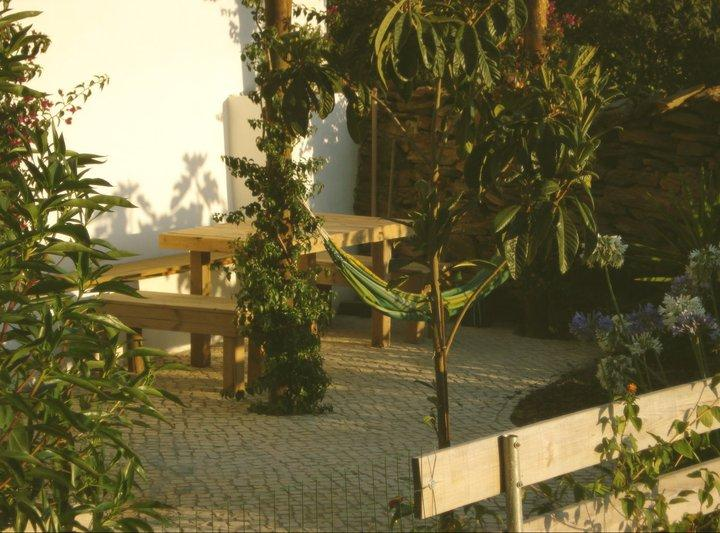 The garden with one out of two outdoor dinning tables
