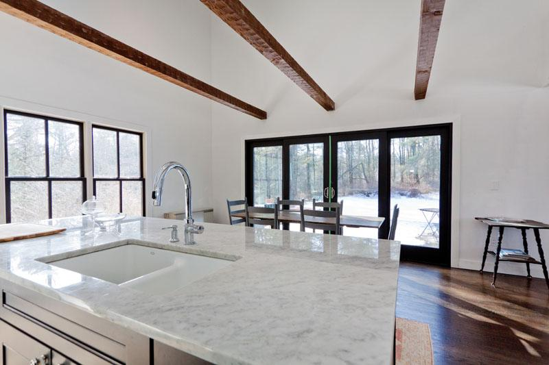 You will love preparing meals in this sleek, modern kitchen with marble countertops